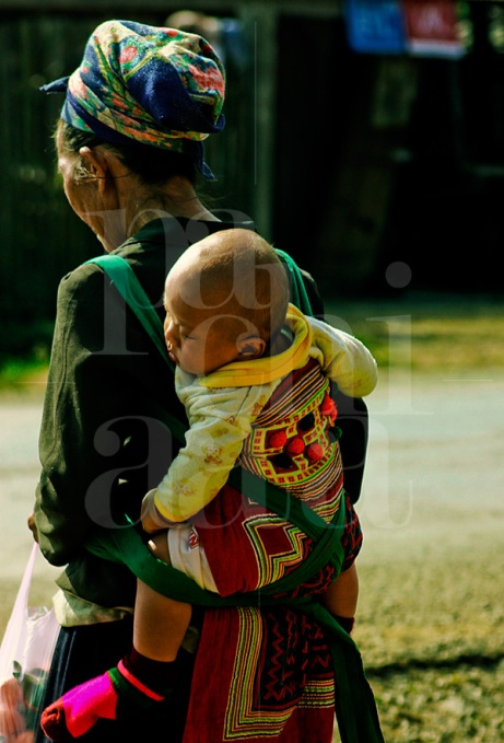 Hmong Grandmother Carrying Her Grandson on a Hmong Textile Baby Carrier